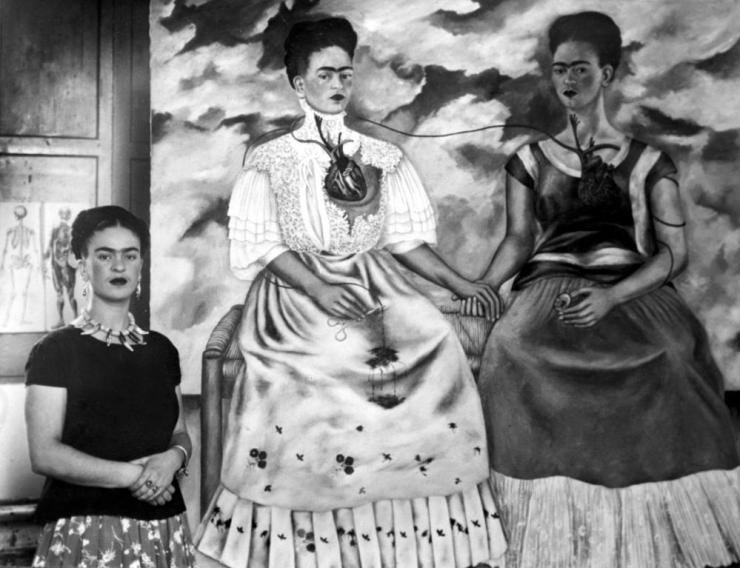 Artist Frida Kahlo with her painting Me Twice