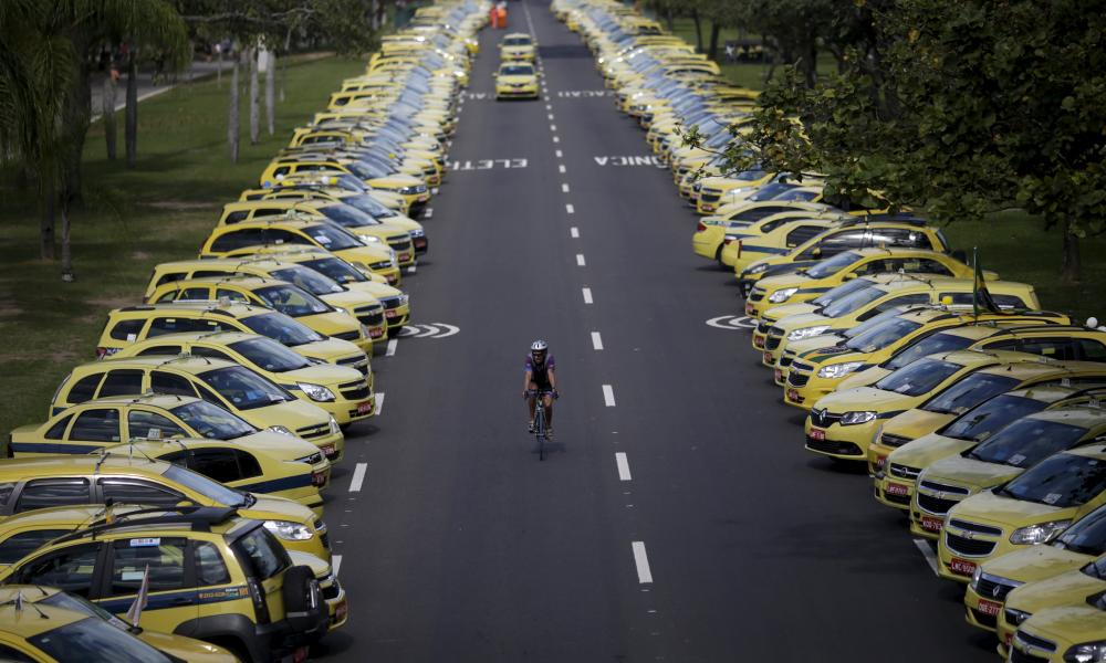 Taxis parked on the street in Rio de Janeiro, Brazil during a protest against Uber.
