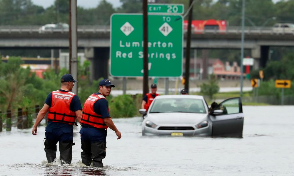 Members of the coast guard help a stranded motorist in the flood waters caused by Hurricane Florence in Lumberton, North Carolina.