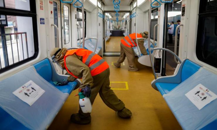 Workers disinfect a train in Manilla, Philippines