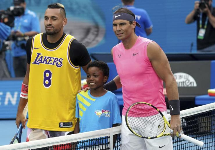 Nick Kyrgios wears an LA Lakers shirt with Kobe Bryant's name on the back before the match.