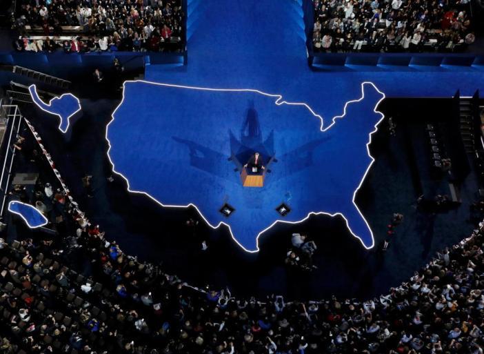 Hillary Clinton's campaign chairman John Podesta addresses supporters.