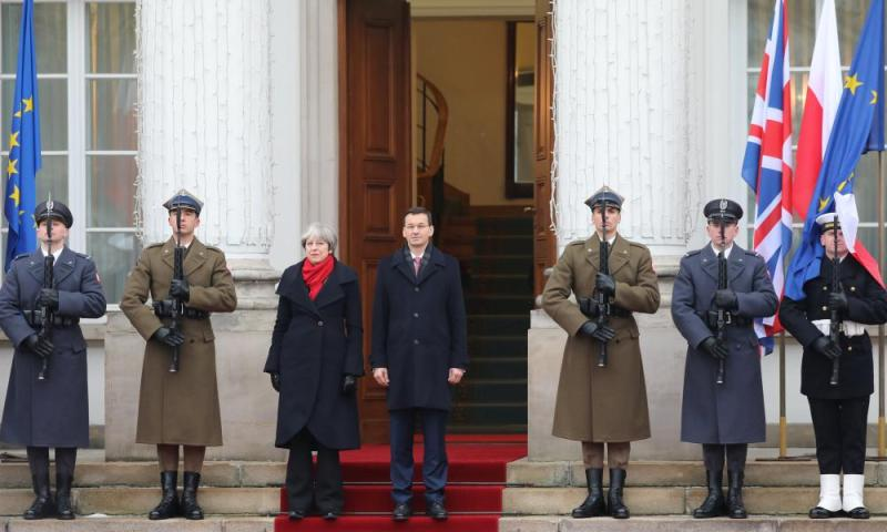Theresa May with Mateusz Morawiecki at a welcoming ceremony in front of the Belvedere Palace in Warsaw.