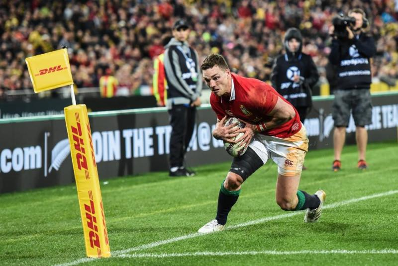 The Lions' George North steps into touch before grounding the ball for a try which was disallowed.