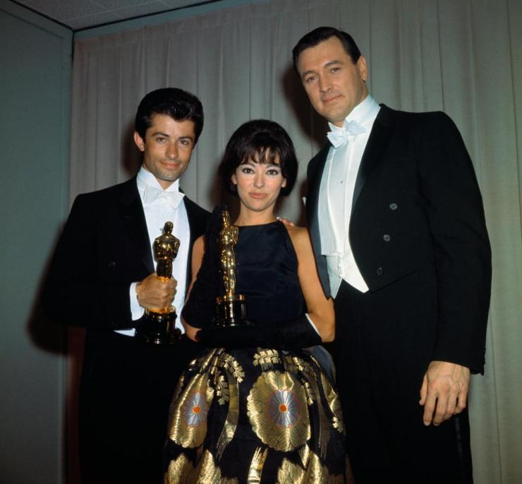 Oscar Winners George Chakiris (L) and Rita Moreno with Rock Hudson at the 1962 Awards ceremony.