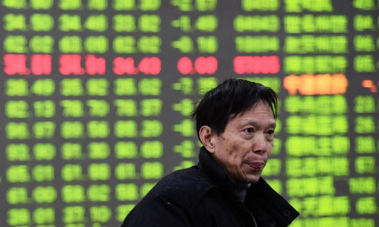 An investor in a stock exchange in Hangzhou, Zhejiang province on Monday.
