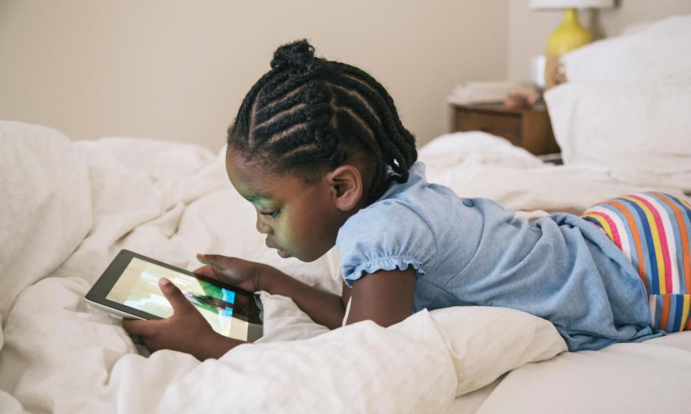 young girl looking at a tablet.