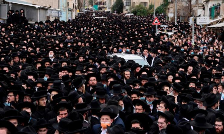 Thousands of Ultra-Orthodox Jews attend a funeral procession for the Head of the Brisk Yeshiva, Rabbi Meshulam Dovid Soloveitchik, in Jerusalem on January 31.