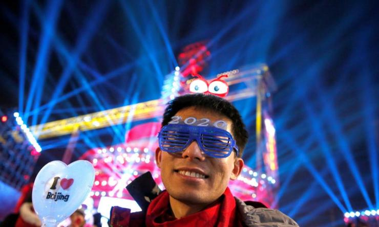 A man takes part in the event of New Year's Eve countdown celebration at Shougang Industrial Park, one of the venues for the Beijing 2022 Olympics, in Beijing, China December 31, 2019.