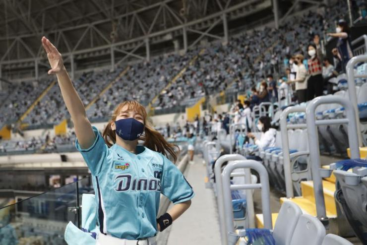 A cheerleader performs during a baseball match between Doosan Bears and NC Dinos at Gocheok Sky Dome in Seoul, South Korea.