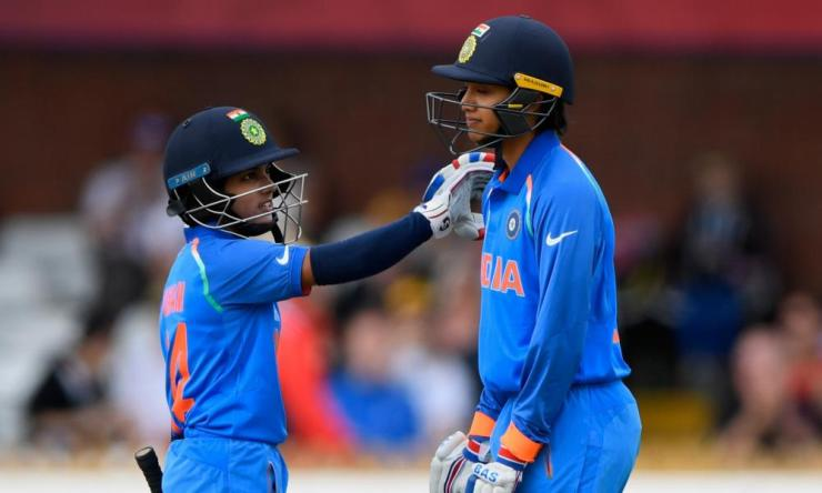 A congratulatory pat on the shoulder from Poonam Raut after her team-mate Smrti Mandhana, right, celebrates her half century.