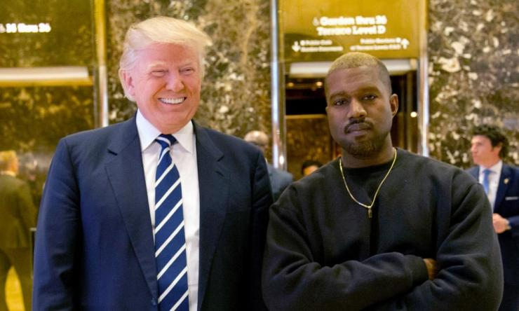 Kanye West pictured with Donald Trump, then president-elect, in the lobby of Trump Tower in New York, December 2016.