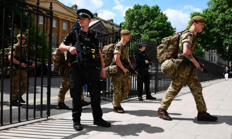 British soldiers enter a Ministry of Defence building