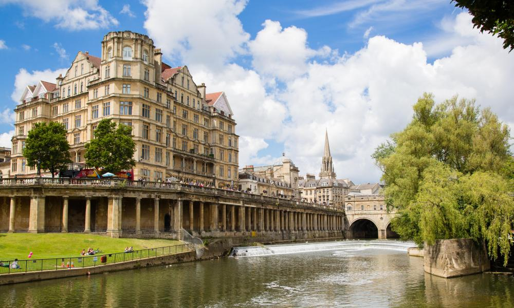 Pulteney Bridge and weir and the Grand Parade on the river Avon in the city of Bath Somerset UK