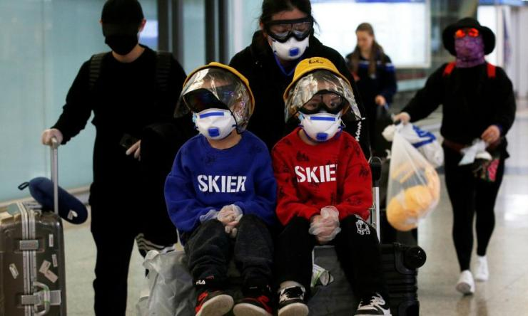 Passengers wear protective face mask and goggles at Hong Kong International Airport, Hong Kong, China March 17, 2020.