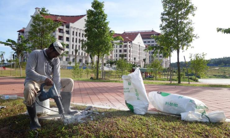 A labourer works on completing the campus.