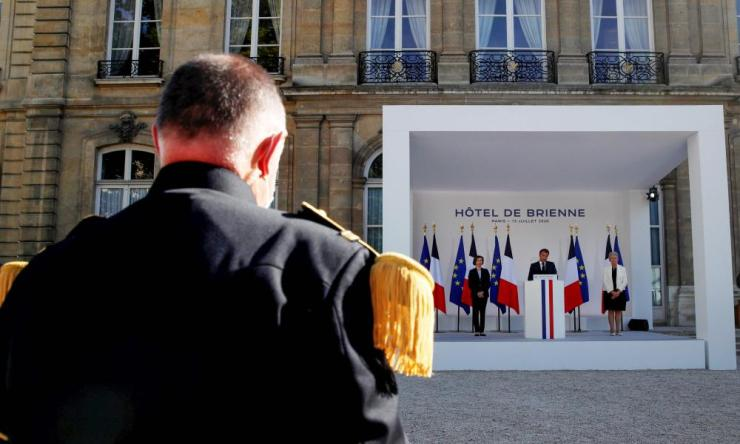 French President Emmanuel Macron speaks flanked by two ministers during an address to France's armed forces on 13 July 2020, on the eve of France's Bastille Day.