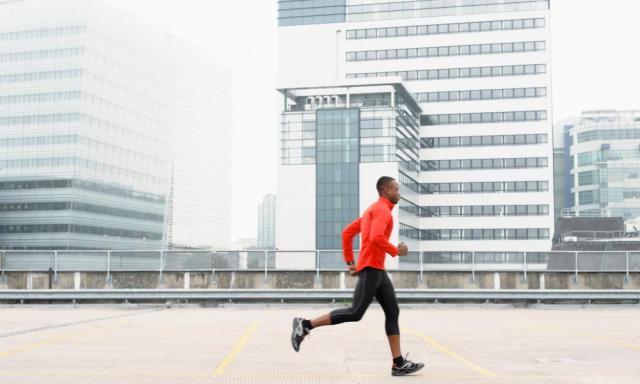 African American runner jogging in city