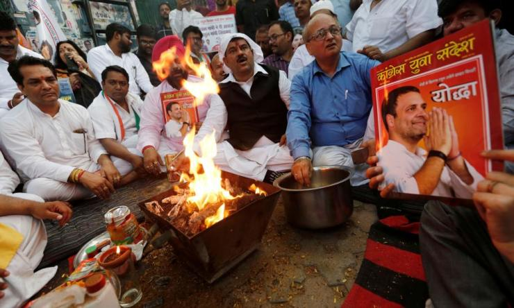 Congress employees perform a special prayer at the party headquarters in Delhi on Thursday.