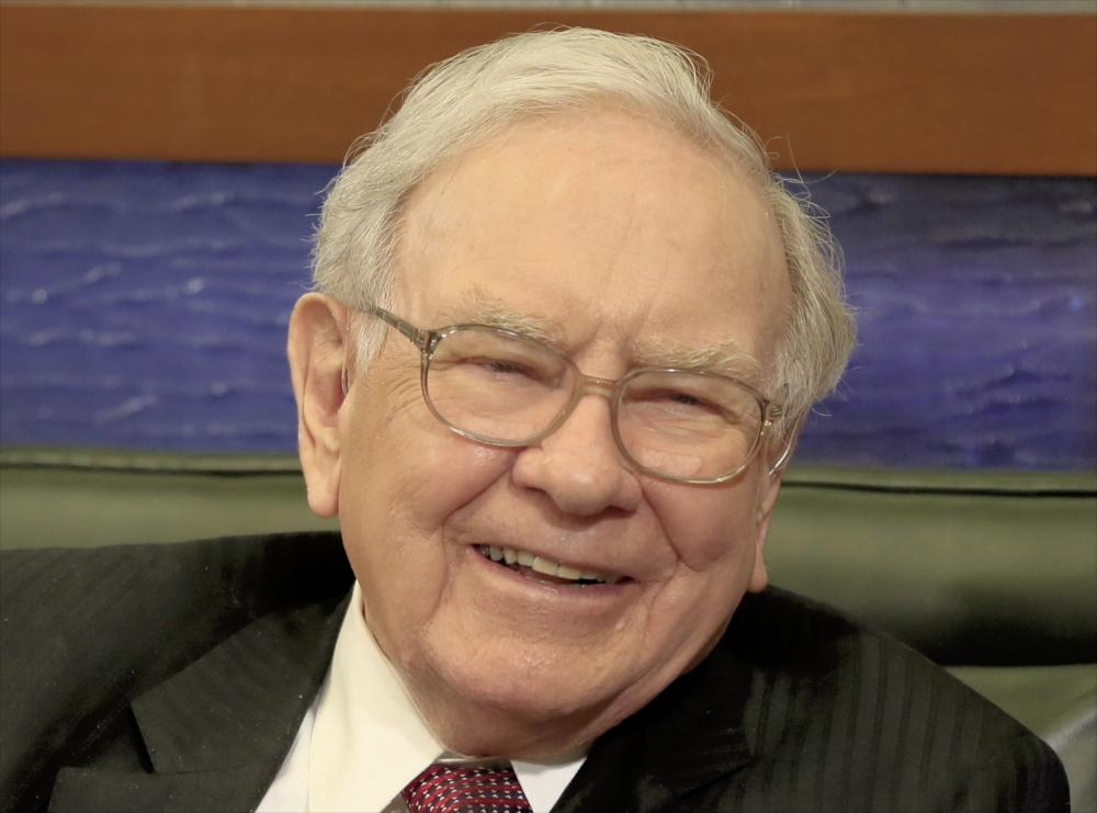 Warren Buffett<br>In this photo from May 4, 2015, Berkshire Hathaway Chairman and CEO Warren Buffett smiles in Omaha, Neb., during an interview with Liz Claman on the Fox Business Network. Warren Buffett will again try to auction on Ebay the world's most expensive lunch this week to raise money for the Glide Foundation- a San Francisco charity that helps the poor and homeless. (AP Photo/Nati Harnik)