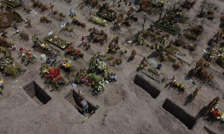 A man digs a grave at the Xico cemetery, as the coronavirus outbreak continues, in Valle de Chalco, Mexico 29 June 2020.