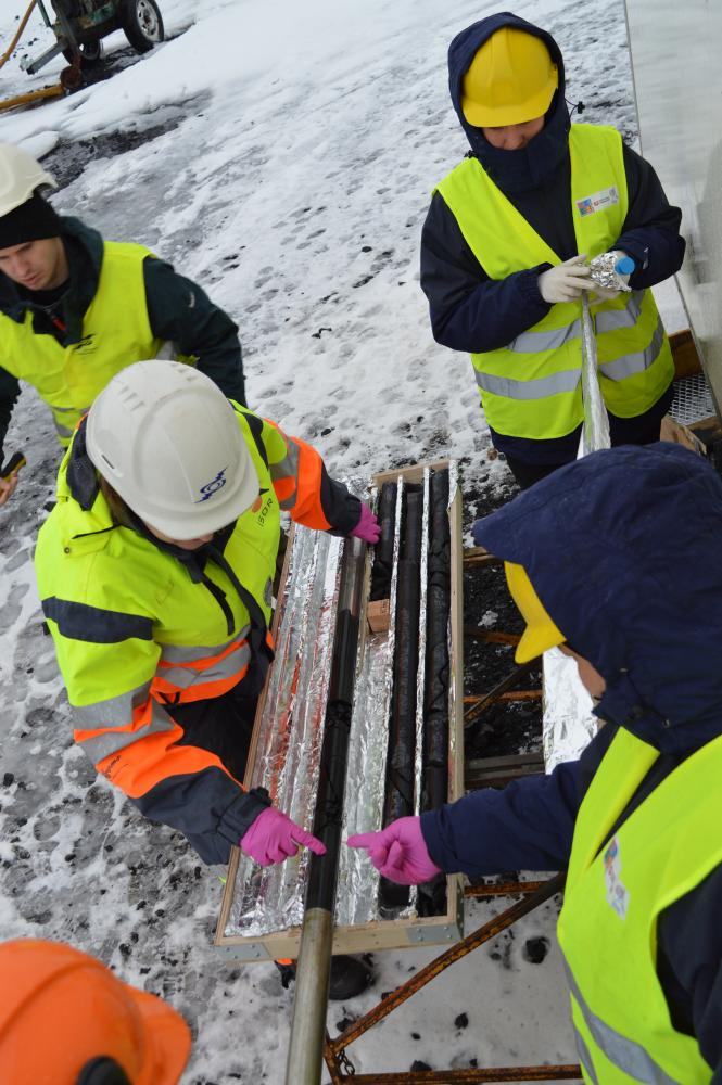 Members of the CarbFix science team handling rock core recovered during drilling at the CO2 injection site.