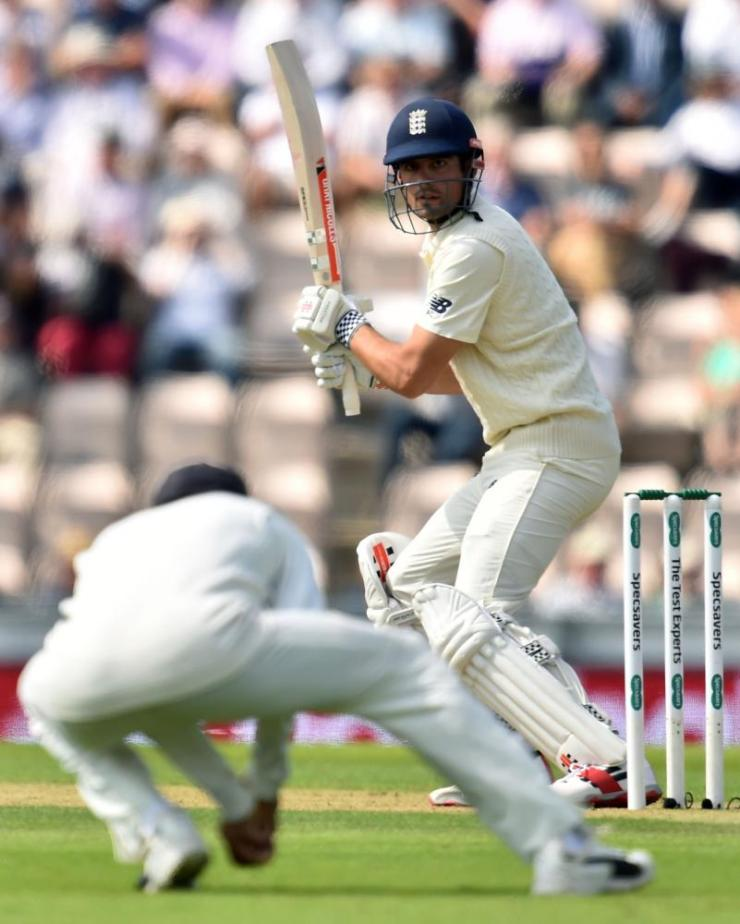 England's Alastair Cook watches as he is caught by India's captain Virat Kohli.