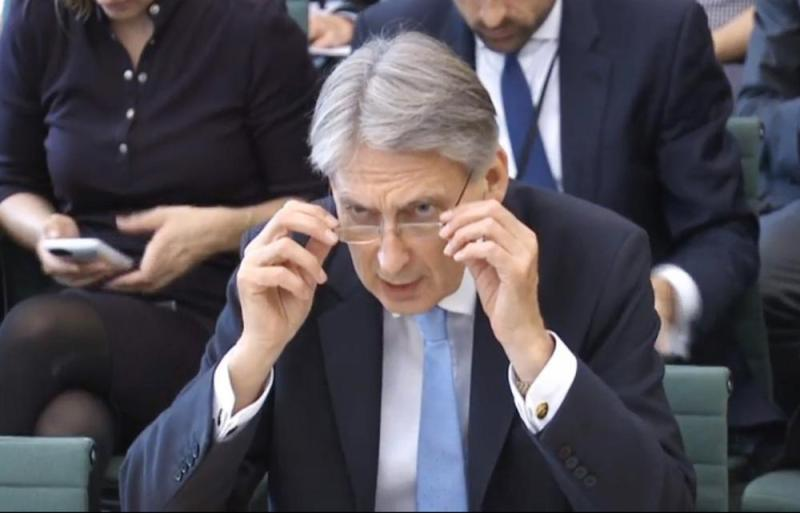 Chancellor Philip Hammond answering questions at the Commons Treasury Select Committee today.