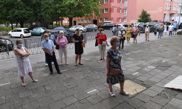 Voters queue while awaiting the opening of a polling stations in Szczecin, Poland, 28 June 2020.