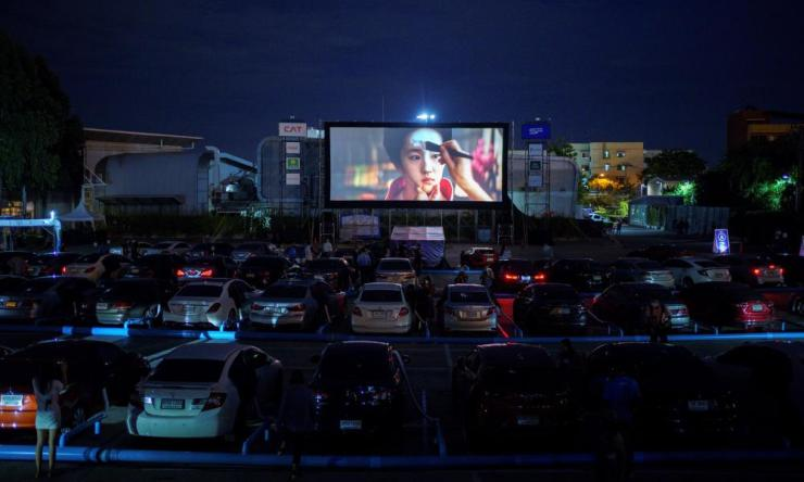 Vehicles parked at the first drive-in movie theatre for people to enjoy movies while keeping social distancing in Bangkok.