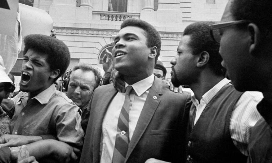 Muhammad Ali leaves the Huston armed forces induction centre with his entourage after refusing to be drafted in 1967.