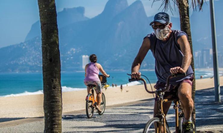 People ride bicycles in Rio de Janeiro, 9 Jun 2020.
