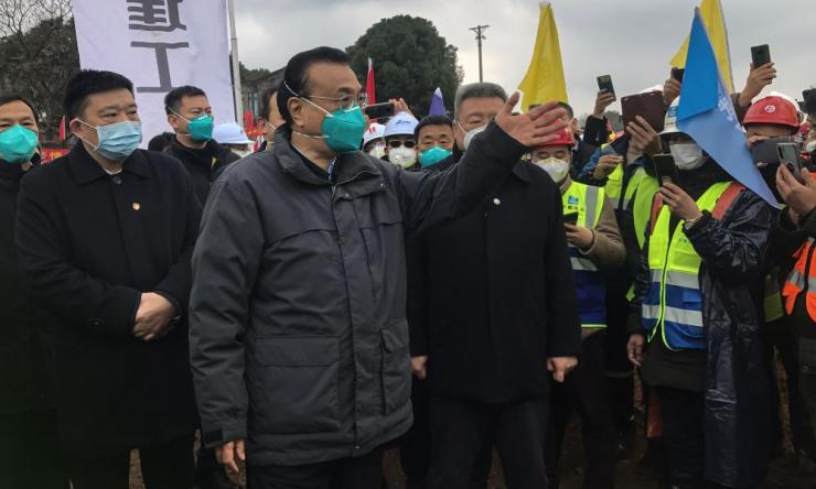 China's Premier Li Keqiang visits a construction site of a new hospital being built to treat patients of a deadly virus outbreak in Wuhan. Li became the most senior Chinese leader to visit Wuhan since the city was struck by the outbreak