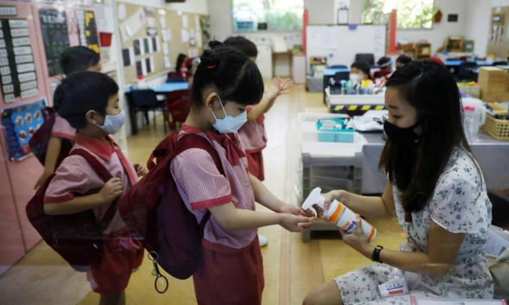 Children returned to school in Singapore on Tuesday after nearly two months away from the classroom.