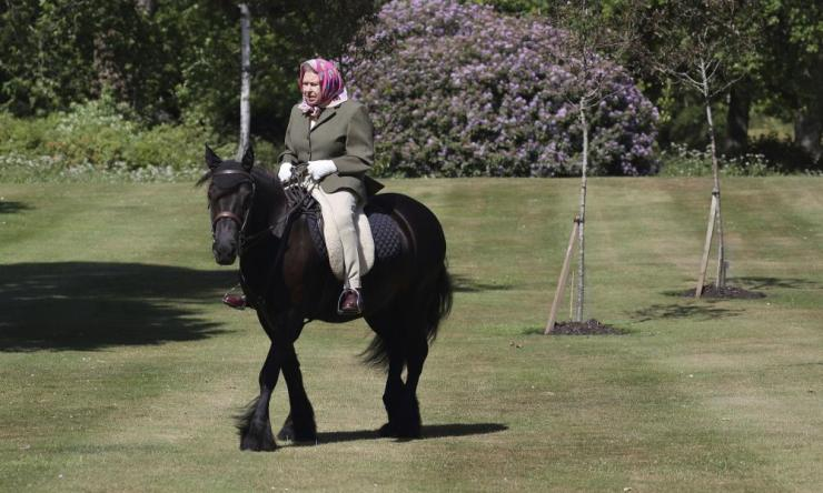 Britain's Queen Elizabeth II rides Balmoral Fern, a 14-year-old Fell Pony, in Windsor Home Park over the weekend at the end of May, in Windsor, England. The Queen has been in residence at Windsor Castle during the Covid-19 coronavirus pandemic.