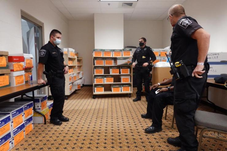 Police stand guard over ballots from the election being stored in the Wisconsin Center before the start of the recount.
