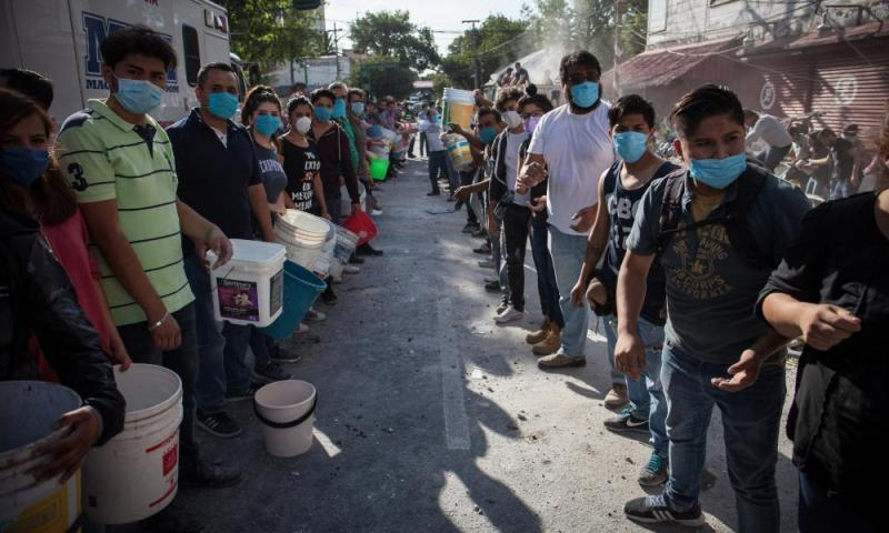 Rescuers and residents look for victims amid the ruins of a building knocked down by a magnitude 7.1 earthquake that jolted central Mexico damaging buildings, knocking out power and causing alarm throughout the capital on September 19, 2017 in Mexico City, Mexico.
