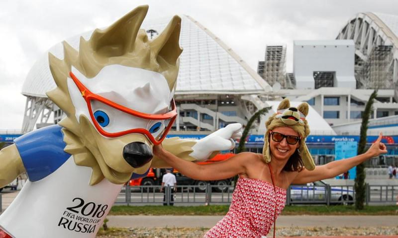 A Belgium fan and her pal pose outside the Fisht Stadium in Sochi.