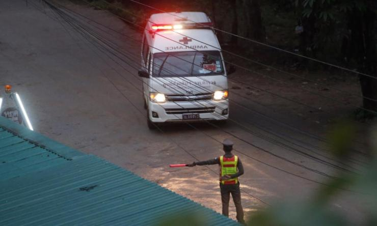One of two ambulances leave the cave in northern Thailand hours after the rescue operation began.