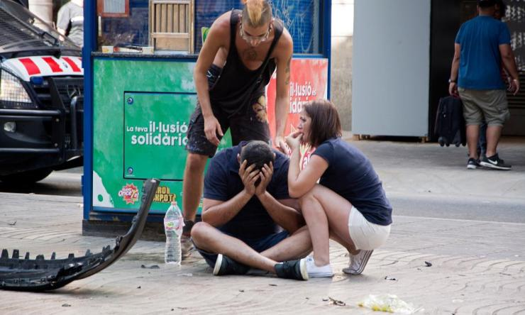 People comfort each other in the aftermath of the attack.