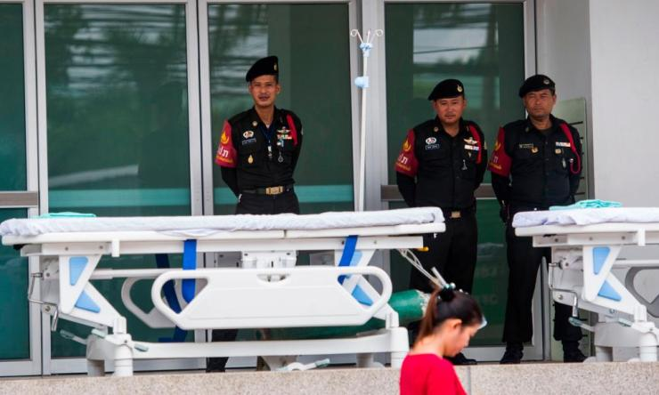 Thai Police stand in front of the hospital in Chiang Rai.