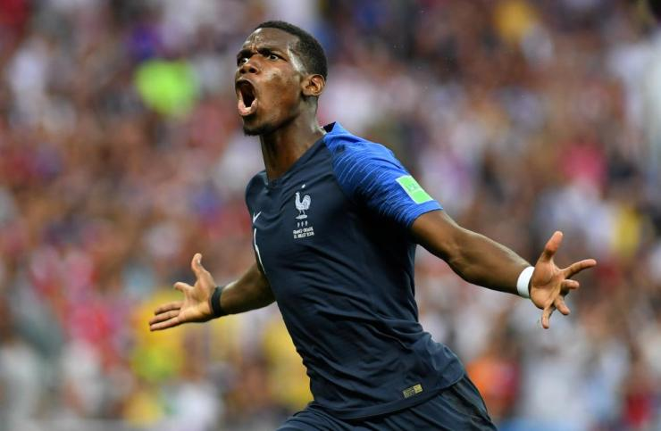 Pogba celebrates number three for France.