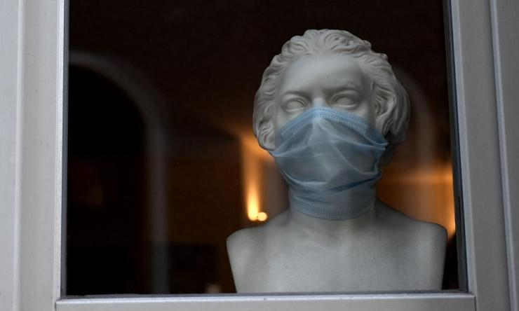 A bust of the former composer Ludwig van Beethoven is decorated with a protective mask in a store window in Weimar, Germany.