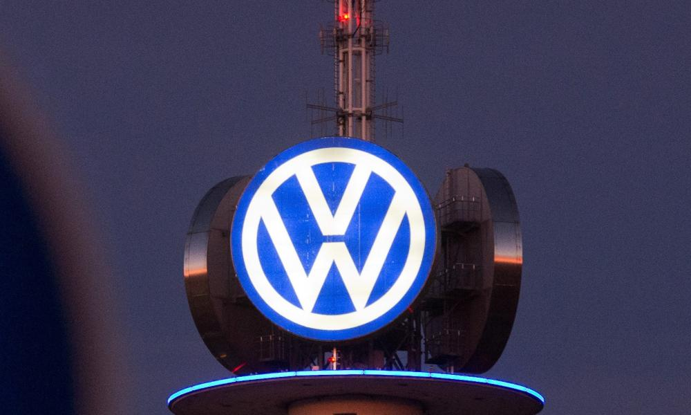 A street sign can be seen in front of the illuminated logo of German car maker Volkswagen (VW) on December 10, 2015 in Hanover, central Germany. Embattled German auto giant Volkswagen is due to provide an update on the latest developments in the massive pollution-cheating storm it has been engulfed in since September. AFP PHOTO / DPA / JULIAN STRATENSCHULTE +++ GERMANY OUT +++JULIAN STRATENSCHULTE/AFP/Getty Images
