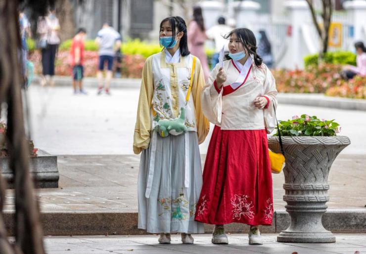 Women in traditional Chinese dress walk in the park in Guangzhou, Guangdong province, China, 1 May 2020.