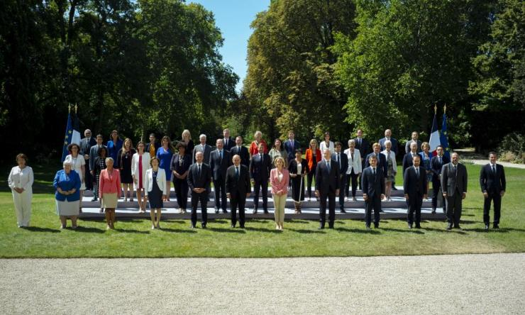 France's President Emmanuel Macron, centrE in the second row, and French Prime Minister Jean Castex, on the left of Macron, pose for a family photo with new Cabinet members after the last weekly cabinet meeting before summer holidays in Paris.