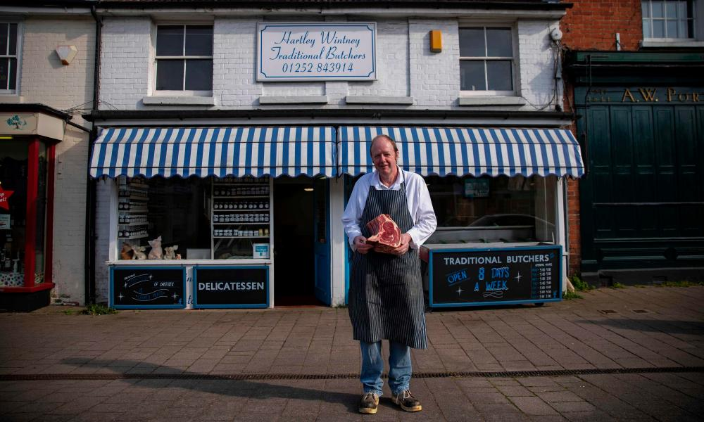 Dave Stanton, 57, a butcher poses for a picture outside his shop in Hartley Wintney, England, on April 25, 2020 during the COVID-19 coronavirus pandemic.