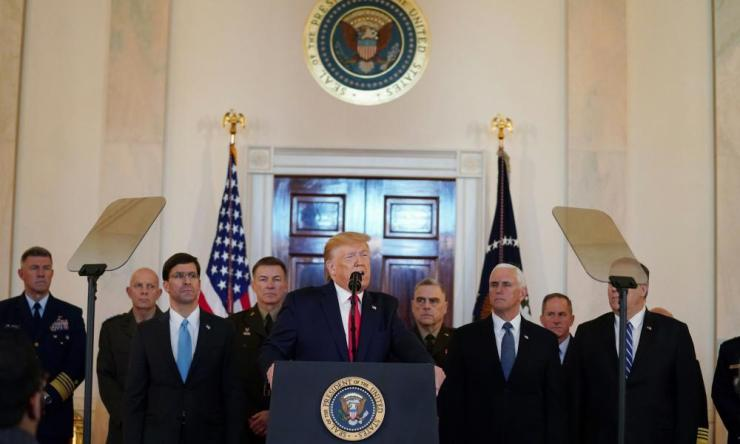 Donald Trump delivers statement about Iran at the White House in WashingtonHe is flanked by Secretary of Defense Mark Esper (left, in blue tie), vice president Mike Pence and secretary of state Mike Pompeo (partially obscured by teleprompter), and military leaders in the Grand Foyer at the White House moments ago
