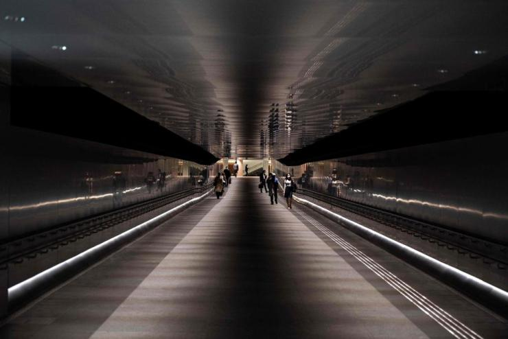 People walk through a train station in Tokyo on 28 April, 2021.