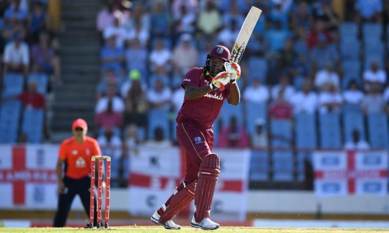 Chris Gayle of the West Indies hits out for six runs.